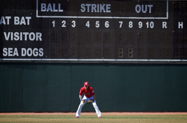 Pitcher Brock Huntzinger of the Portland Sea Dogs shags fly balls in left field during an April practice at Hadlock Field in Portland. Bangor Community Day will be held at the ballpark Monday when the Sea Dogs host the New Britain Rock Cats.