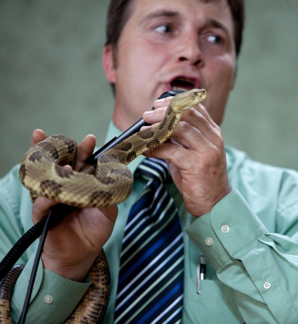 Pastor Mack Wolford handles a rattlesnake during a service at the Church of the Lord Jesus in Matoaka, W.Va., in 2011.