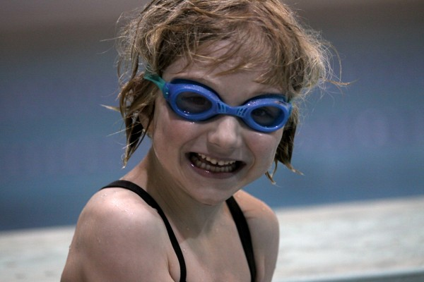 Lori Anne Madison, 6, shown at a recent swim practice, is the youngest contestant to advance to the national level of the Scripps National Spelling Bee.