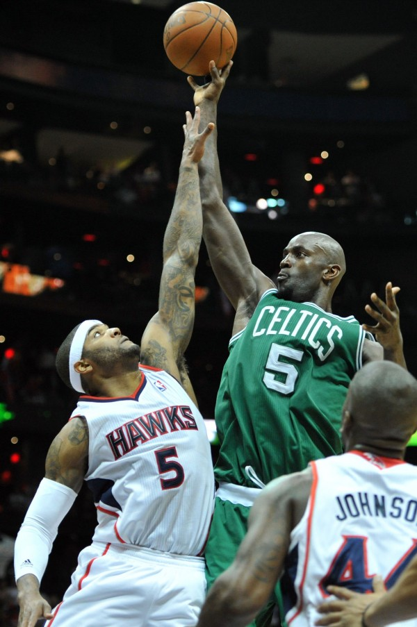 The Boston Celtics' Kevin Garnett (top right) shoots against the Atlanta Hawks' Josh Smith during the second half of Game 2 of the Eastern Conference first-round matchup at Philips Arena in Atlanta, Georgia, on Tuesday, May 1, 2012.