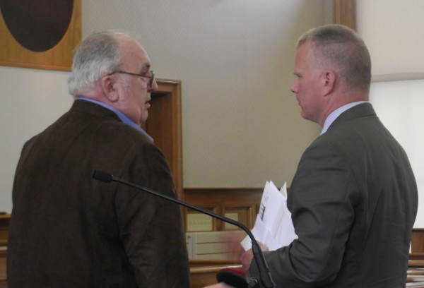 Robert Strout (left) of Orient stands with his attorney, Stephen Smith of Bangor, just before he heads off to prison on Wednesday, May 23, 2012. Strout was sentenced in Superior