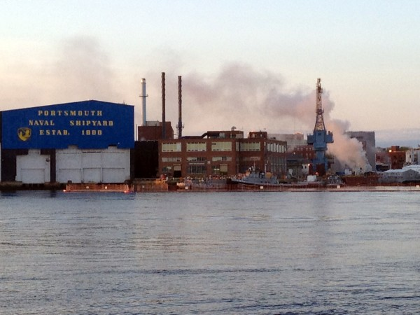 A fire burns on a nuclear submarine at the Portsmouth Naval Shipyard in Kittery, Maine, on Wednesday