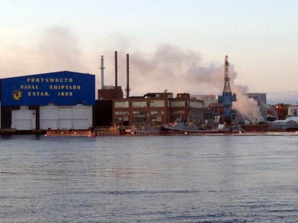 A fire burns on a nuclear submarine at the Portsmouth Naval Shipyard in Kittery, Maine, Wednesday, May 23, 2012.