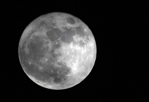 This Saturday, March 19, 2011 photo shows a full moon over Pembroke, N.Y. at its closest point to the Earth since March 1993. The biggest and brightest full moon of the year arrives Saturday night, May 5, 2012 as our celestial neighbor passes closer to Earth than usual. Saturday's event is a &quotsupermoon,&quot the closest and therefore the biggest and brightest full moon of the year.