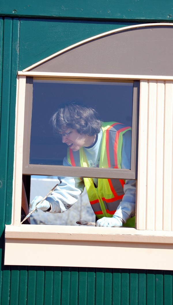 Carolyn Ackerman was among nearly two dozen volunteers who turned out Saturday to spruce up the rail cars operated throughout the summer in Ellsworth by the Downeast Rail Heritage Trust. The first 11-mile excursion leaves the platform behind Cadillac Mountain Sports on Saturday, May 26.