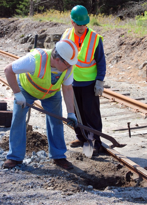 Charlie Freeman (left) and Shawn Melvin spent Saturday replacing ties along the section of the Down East Scenic Railroad near Davis Street in Ellsworth.