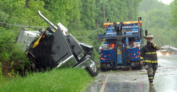 Traffic backs up after a tractor-trailer rolled over in a ditch and brought down a power line going northbound on Route 7 in Dixmont Tuesday morning.