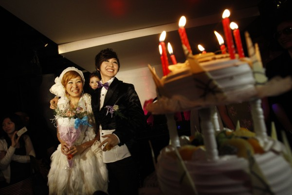 A same-sex female couple stands by their cake during a mass wedding at a night club in Taipei, Taiwan, when 60 same-sex female couples tied the knot during this mass wedding in the nation that does not legally recognize same sex marriages in August 2011. While gay-rights activists around the world hailed President Barack Obama's support for same-sex marriage as a symbolic victory, for many the idea of legal unions between homosexuals is a distant dream.