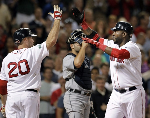 Boston Red Sox's David Ortiz, right, celebrates his solo home run against the Detroit Tigers with Kevin Youkilis (20) during the seventh inning of a baseball game at Fenway Park in Boston Tuesday, May 29, 2012. Tigers catcher Alex Avila is at center.