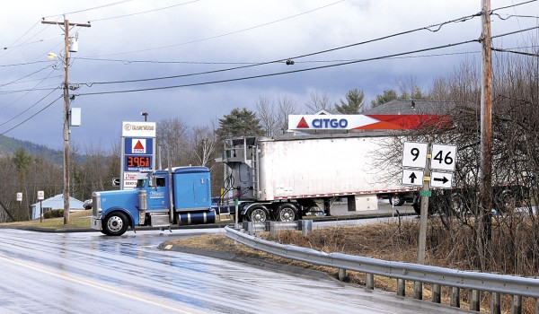An east-bound tractor hauling a chip van stops at the intersection of Routes 9 and 46 in East Eddington.