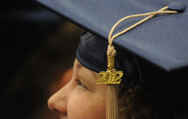 A newly-minted graduate's mortar board tassel is decorated with a metallic  graduation year charm during the Saturday morning commencement at the University of Maine in Orono.