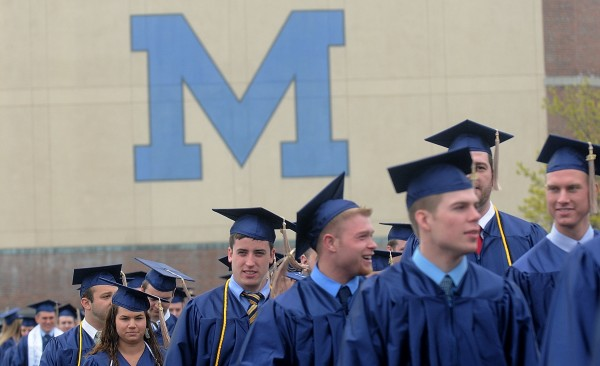 University of Maine students march from the Memorial Gym Field House to Alfond Arena, site of their Saturday morning commencement at the University of Maine in Orono. An afternoon commencement also took place in the arena.