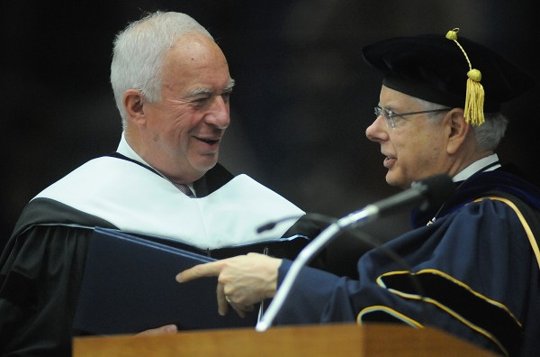 Dr. Paul Ferguson, president of the University of Maine, conferred an honorary degree on Owen W. Wells of Falmouth, former president and CEO of the Libra Foundation and UMaine alumnus, Class of 1965. Wells was the morning commencement speaker during Saturday's morning commencement at the University of Maine in Orono.