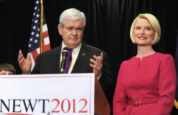 Newt Gingrich, with his wife, Calista, announces he is suspending his campaign for the Republican presidential nomination May 2, 2012, in Arlington, Va. Gingrich said he decided to leave the race after his rival, former Massachusetts Gov. Mitt Romney, surged ahead in recent primary elections.