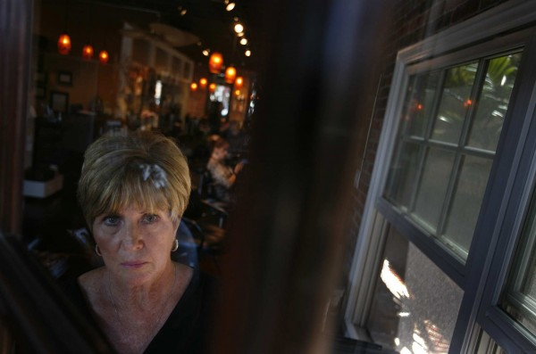 Jo Ann Snyder, a 57-year-old hair salon manager in Seal Beach, poses for portrait on April 25, 2012. Snyder is suing Blue Shield of California in a potential class-action suit that accuses the nonprofit insurer of keeping medical prices secret and allowing hospitals and doctors to overcharge consumers with high deductible plans.