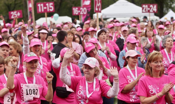 About 5,000 fewer people have registered for the June 3, 2012, Komen Race for the Cure, the group's 5K walk, resulting in about a half-million-dollar drop in pledges. In this photo, participants dance and celebrate at the end of the 2010 event.
