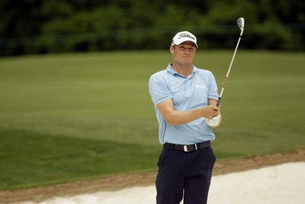 Nick Watney watches his shot from a 16th fairway sand trap during the second round of the Wells Fargo Championship golf tournament at Quail Hollow Club in Charlotte, N.C., Friday, May 4, 2012.