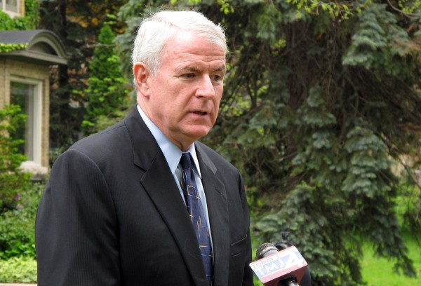 Milwaukee Mayor Tom Barrett talks to reporters at his Milwaukee home on Wednesday, May 9, 2012.