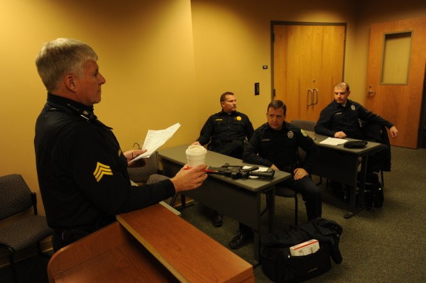 Sgt. Bob Bishop (left) leads a roll call for an evening shift of officers headed out on patrol at the Bangor Police Station in December 2010. Attending the roll call are officers Jeff Millard (second from left, who retired from the force in the fall of 2011), Jim Dearing and John Robinson.