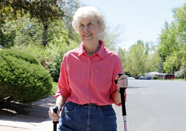 In this April 23, 2012, photo, Elaine Vlieger, 79, walks near her home near Denver, Colo.  Vlieger is making some concessions to her early stage Alzheimer's, but isn't ready to give up either her home or her independence. She stays active with yard work and daily walks.
