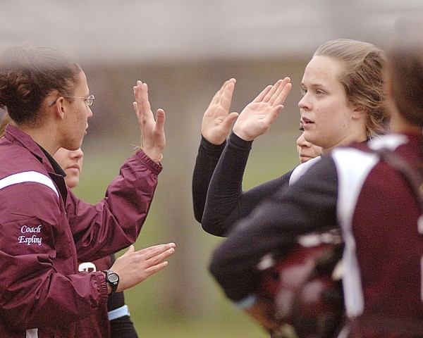 Orono High School softball coach Kristen Espling (left) congratulates pitcher Andria Foster at the end of the second inning of their game in Dexter, Wednesday, May 2, 2012.