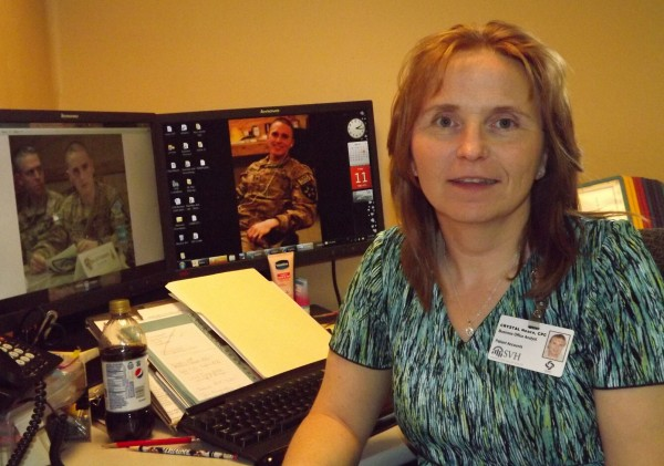 Crystal Neace sits at her desk at Sebasticook Valley Hospital in Pittsfield with her son, Mark Neace Jr., on her computer desktop on Friday, May 11, 2012. On Tuesday, Mark sent his mom a Mother's Day video from Afghanistan, where he's stationed.