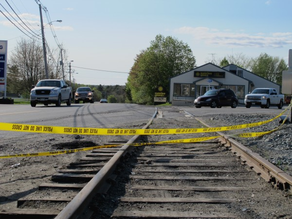 Police tape warns drivers away from railroad tracks at a confusing intersection and curve on Route 1A in Ellsworth. Over the span of three days during the week of May 13, three cars driving in rain or fog ended up on the tracks after failing to navigate the curve.