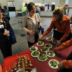 Michelle Ferm (left) and Paula Eaton (center) sample a salad made by Ann Marie Orr of Ann Marie's Kitchen at the Bangor Buisness Expo at the Bangor Civic Center on Thursday, May 10, 2012. Thursday's expo marks the first time food vendors and resturants were represented with food being offered to attendees.