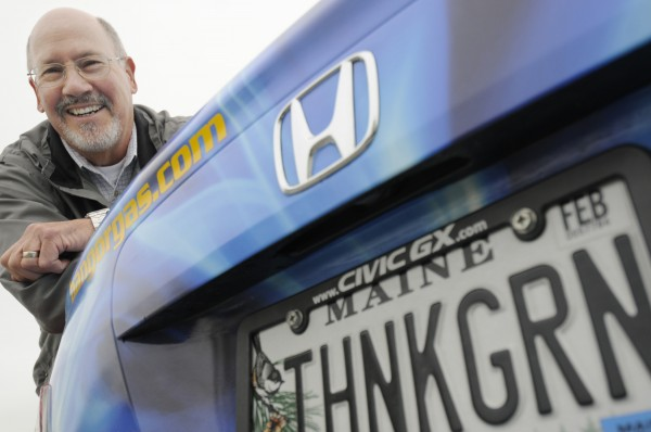 Jonathan Kunz, manager of marketing and sales for Bangor Natural Gas, shows off one of the company's new natural gas-powered Honda Civics in downtown Bangor Wednesday, May 16, 2012.