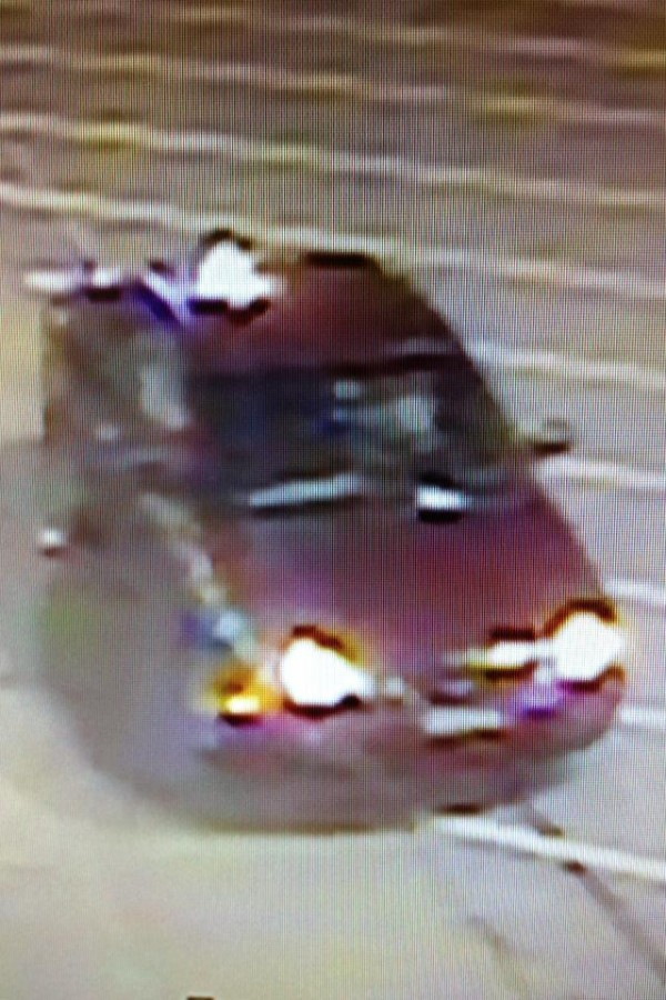 Bangor Police Department has released two images taken recently from Best Buy's surveillance cameras. One shows a suspect carrying a boxed laptop and one shows the man's red- or burgundy-color car in the parking lot.