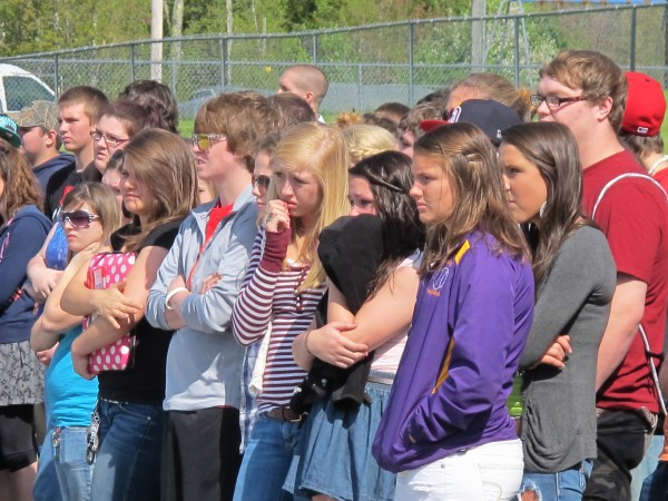 A group of Bucksport High School students react while watching emergency crews respond to a mock fatal accident staged behind their school on Thursday, May 17, 2012. Students played the parts of the injured and deceased victims during the daylong event, which is intended to make students aware of the consequences of impaired, distracted or reckless driving.