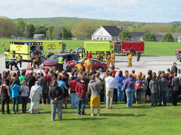 Students at Bucksport High School watch on Thursday, May 17, 2012, as emergency crews respond to a mock double-fatal accident scene behind the school. The staged event, which was organized by students as well as police, is intended to instill in students the dangers of impaired, distracted and reckless driving.