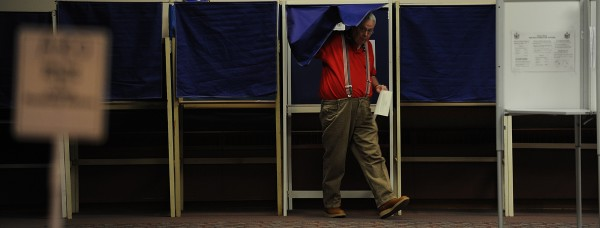 Jeff Barnes of Bangor leaves the voting booth in June 2009 after marking his ballot  at the Bangor Civic Center polling station. Bangor residents were voting on a $42 million school budget referendum that summer. It was the second year that city voters have had the final say on the school budget. The budget was accepted in Bangor by a vote of 463-123.