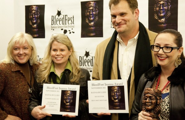 "Cassidy McMillan, director of ""&quotRats & Bullies,&quot"" and Ray Buffer, the film's co-director, pose with their awards at the BleedFest Film Festival in Nov. 2011, in Burbank, Calif."