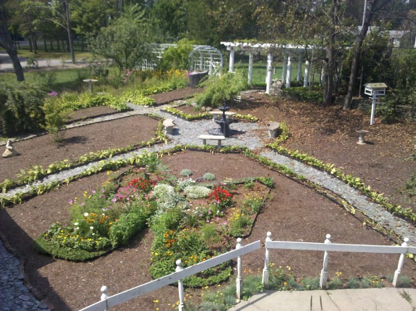 The butterfly garden, constructed by master gardeners at Brewster Inn in Dexter, is in full bloom during summer 2011.