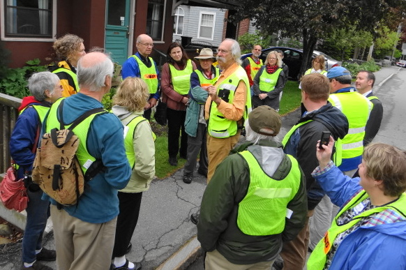 Dan Burden (center) pauses on Chestnut Street in Camden during a walking tour on Tuesday. Burden led workshops in Thomaston and Camden on how to make towns more pedestrian friendly.