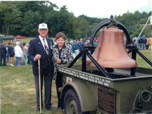 Retired Col. George C. Benjamin and wife Ruth, of Auburn, look over the antique Freedom Bell that Cole Land Transportation Museum has used in Bangor's patriotic parades over the years. Benjamin will give the final remarks during the last reunion of World War II's 5th Armored Division on June 16 in Bangor.