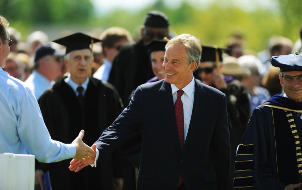 Former British Prime Minister Tony Blair shakes hands with people as he walks with the 2012 graduating class of Colby College during commencent ceremonies in Waterville on Sunday, May 20, 2012.