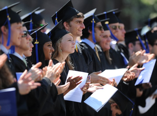 Colby College graduates applaud former British Prime Minister Tony Blair after he gave his commencement address on Sunday, May 20, 2012, in Waterville.