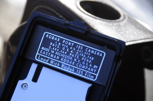 A camera specification placard is affixed to the interior of Duncan Bailey's vintage Kodak Pony 135 camera.