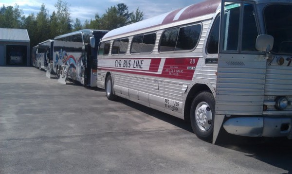 A line of buses on display at the Saturday, May 19, 2012 celebration of Cyr bus company's 100th anniversary. About 500 people, including government representatives, local officials, employees past and present and their families, turned out for the event over the course of the afternoon, according to Joseph Cyr.