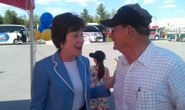 U.S. Sen. Susan Collins chats with Joseph Cyr, president of John T. Cyr and Sons, before the start of a ceremony Saturday, May 19, 2012, celebrating the transportation company's 100th year of business in Old Town.