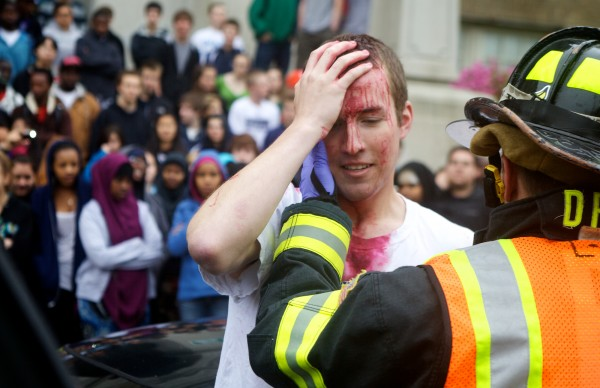 A Portland High School student is pulled from a simulated drunk driving car wreck on Cumberland Avenue Wednesday morning May 2, 2012, while his classmates watch. Students Against Destructive Decisions organized the event.