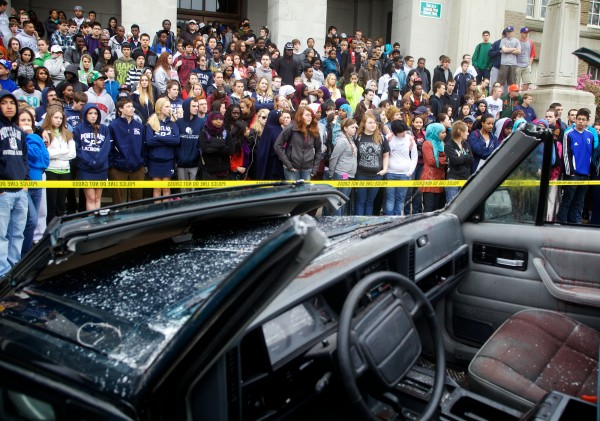 Portland High School students watch a simulated crash scene, caused by a drunk driver, unfold in front of the school on Cumberland Avenue Wednesday morning May 2, 2012.
