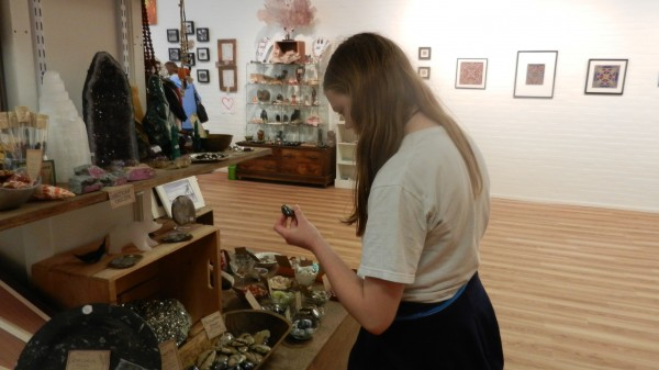 The Rock & Art Shop at 36 Central St. was among several stops that Serena Dunroe, 14, of Bangor (shown above) and her friend, Jakob Grey-Purvis, also 14 and from Bangor, made during Fusion Bangor's Downtown Proud Open House on Wednesday, May 16. During the event, businesses that usually close by 5 p.m. or 6 p.m. stayed open another hour or two as a way to promote downtown businesses. Most of the participating businesses offered discounts, giveaways or refreshments.