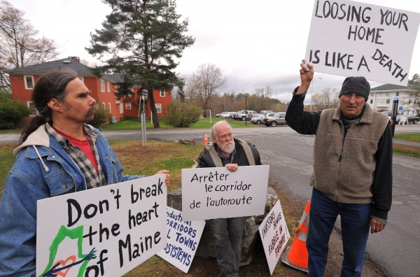 David Bessler of Atkinson (from left), Peter Eldredge of Guilford and Peter Brenc of Dover-Foxcroft protest the proposed east-west highway outside the Wells Conference Center on the University of Maine campus in Orono in April.