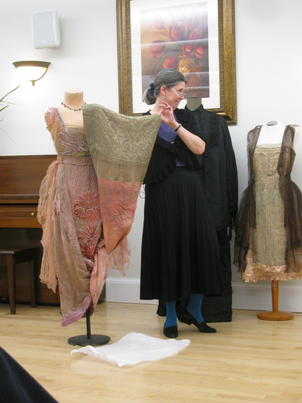 Megan Pinette, president of the Belfast Historical Society and Museum, shows off a gown from the House of Worth on Saturday, May 19, 2012. The Parisian couture dress was worn at a presidential ball during World War I.