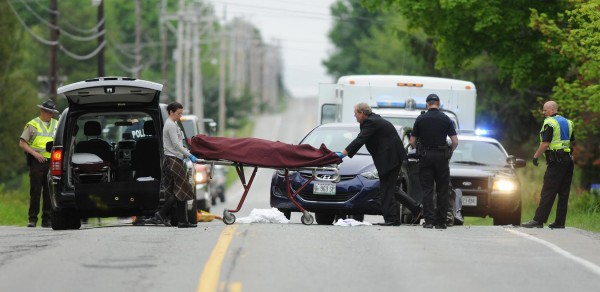 The body of a female motorist is removed from the scene of a two-car accident on Union Street on Friday.