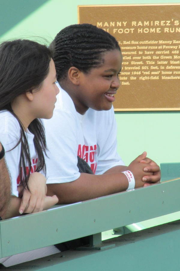 Suki Chau of Hong Kong and Thando Dlamini of South Africa, who are both freshman exchange students at Thornton Academy in Saco, enjoy their first exposure to the game of baseball on Tuesday, May 29, 2012, during batting practice atop the Green Monster at Fenway Park.