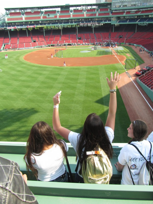 Taylor Duranceau of Saco calls for a member of the Boston Red Sox to hit a ball atop Fenway Park's Green Monster on Tuesday, May 29, 2012, during batting practice. Duranceau was among 20 high school students from Maine who traveled to Tuesday's game as part of a celebration.